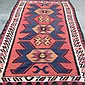 CARPET: HAND-KNOTTED TURKISH KILIM - All wool with red field, three large tarantula devices with smaller repeats inside a series of...