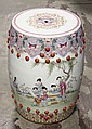 CHINESE CERAMIC GARDEN SEAT - Decorated with elaborate polychrome borders both top and bottom and with scenes of ladies in a garden ...