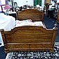 A large Victorian walnut bed and base, having four