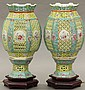 PAIR OF CHINESE ENAMELED             PORCELAIN LANTERNS             on wooded base             total height- 12