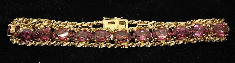 LADIES 14KT YELLOW GOLD             BRACELET with (21) rhodolite             garnets             appraised value- 2,059