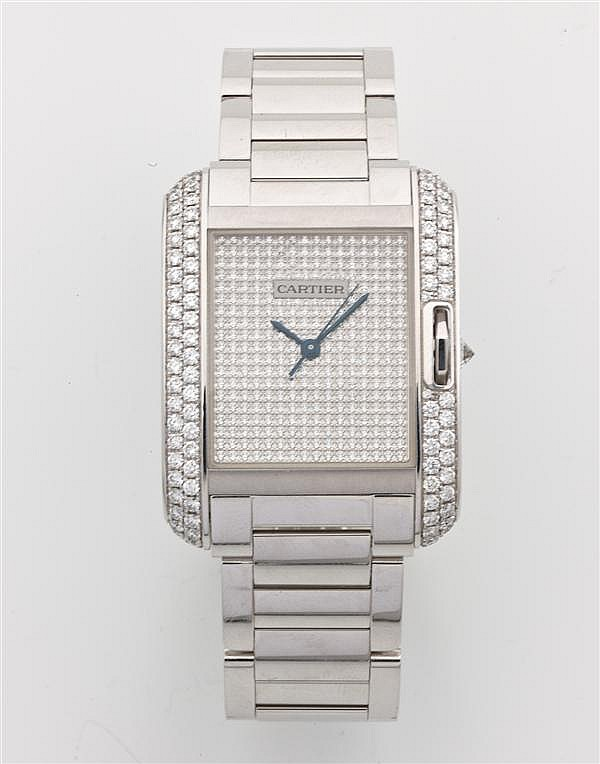 CARTIER TANK ANGLAISE MOYEN MODLE SRIE CONTEMPORAINE Montre bracelet en or gris. Botier rectangulaire. Cadran entirement pav de...