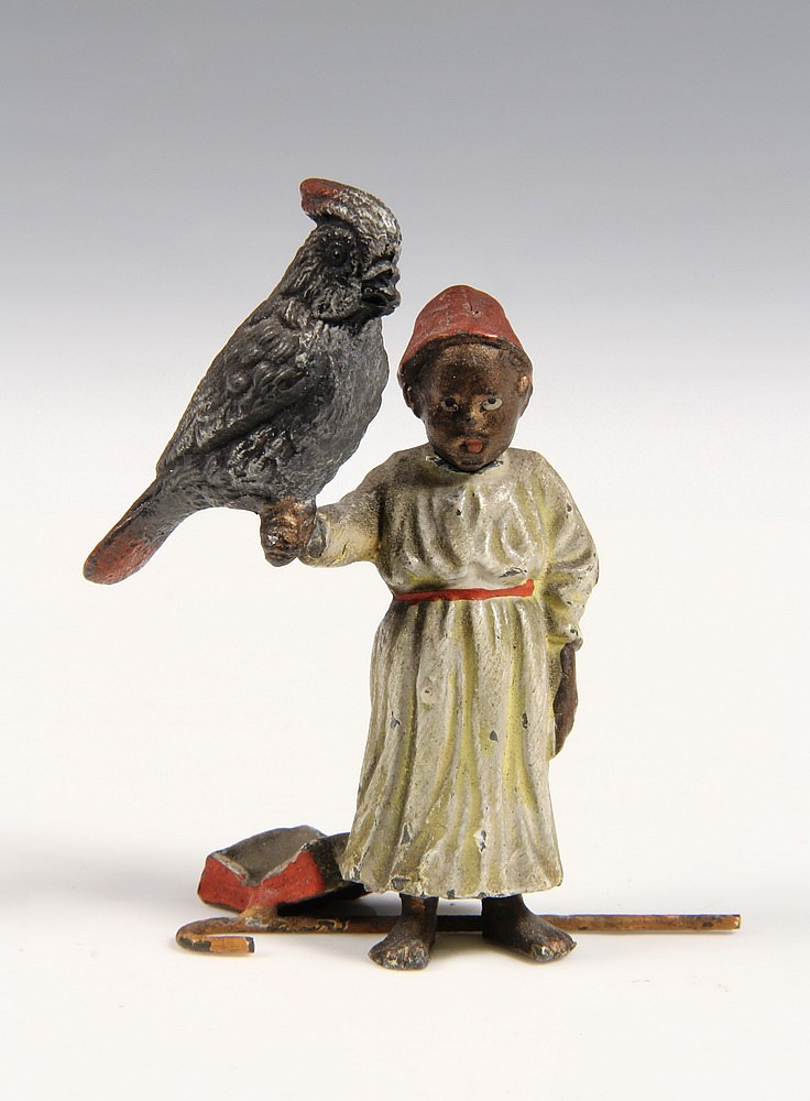 AUSTRIAN BRONZE - Cold Painted Bronze Figure of Turkish Boy with large bird on his raised arm, book and walking stick at his feet, with