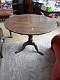 An 18th century oak tilt top tripod table