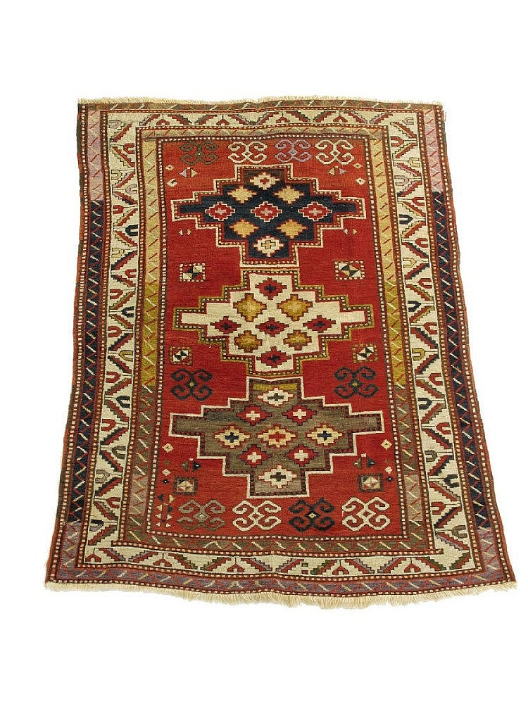 A Kazak `three medallion` rug, south west
