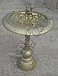 A cast iron 20th century bird bath, painted gold.