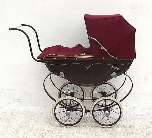 A child's/dolls pram in maroon with sunshade