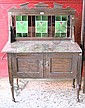 An Edwardian marble topped washstand with green floral art nouveau style tiled splashback.