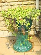 A pair of green glazed flower planters on matching stands, 57cm high two)