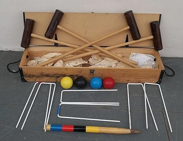 A boxed croquet set with plastic balls, hoops and
