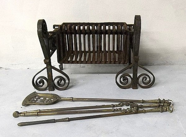 A wrought iron fire basket with removable bottom