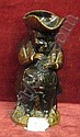Victorian treacle glazed Toby figure jug, taking a pinch of snuff, height 9.5in