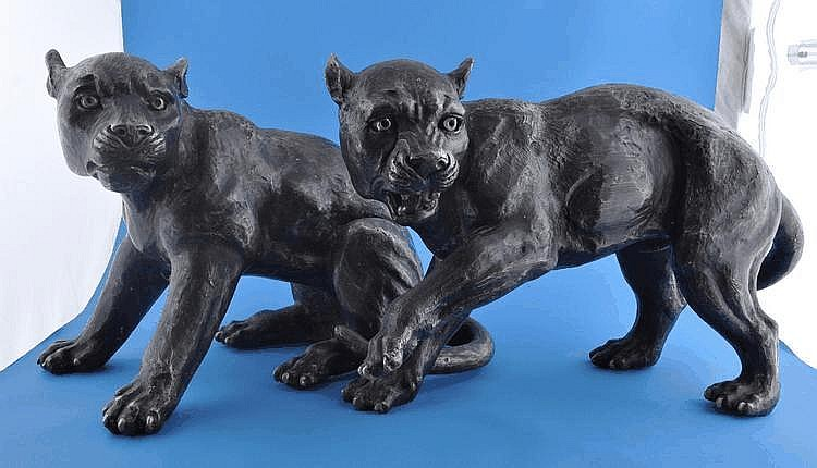 A pair of bronze pumas, height 12''.