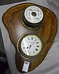 A Ships BAROMETER and a Ships CLOCK, mounted upon