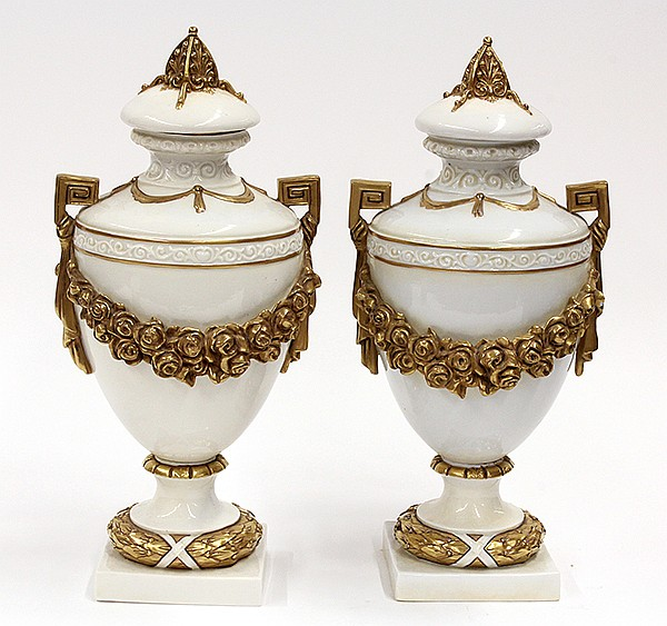 Pair of Continental porcelain urns