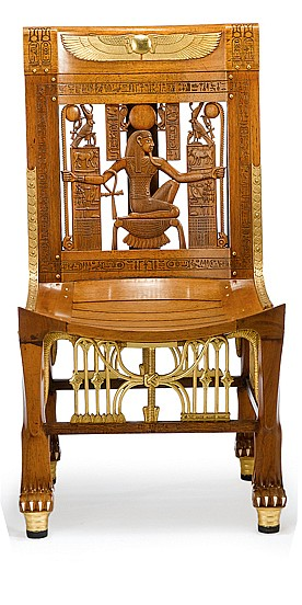 Egyptian revival gilt metal mounted cedar armchair, circa 1928, From an original found in the tomb of Tutankamen, the rectangular pierc