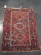 Two Persian rugs, circa 1920, A Malayer rug, West Persia, 5 ft. 11 in. x 3 ft. 10 in.; and a Karadja rug, Northwest Persia, 4 ft. 4 in.