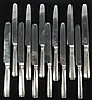 Set of twelve George III silver dinner knives, moses brent, london, circa 1800, The threaded handles with engraved family crest of a si