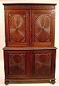 Anglo-colonial rosewood cabinet, 19th century, In two parts: the upper section with carved cornice over two heavily floral carved and r