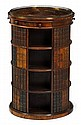 Fine Regency rosewood revolving bookcase, circa 1810-20, The circular brass galleried top with central octagonal hinged compartment enc