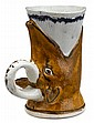 Unusual Prattware mug, circa 1815, Molded in the form of a foxes head, the feather-edged cup emerging from its mouth, handle to one sid