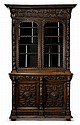 Continental Renaissance Revival carved oak cabinet, 19th century, In two parts: the upper section with lift-off cornice carved to show