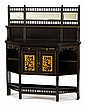 Aesthetic movement gilt and ebonised cabinet, circa 1878, The superstructure with original mirrored panels and a balustrade row above a