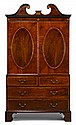 George III Sheraton period rosewood crossbanded inlaid mahogany linen press, circa 1790, In two sections, the swan neck pediment over d
