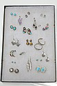 TWENTY PAIRS OF EARRINGS.