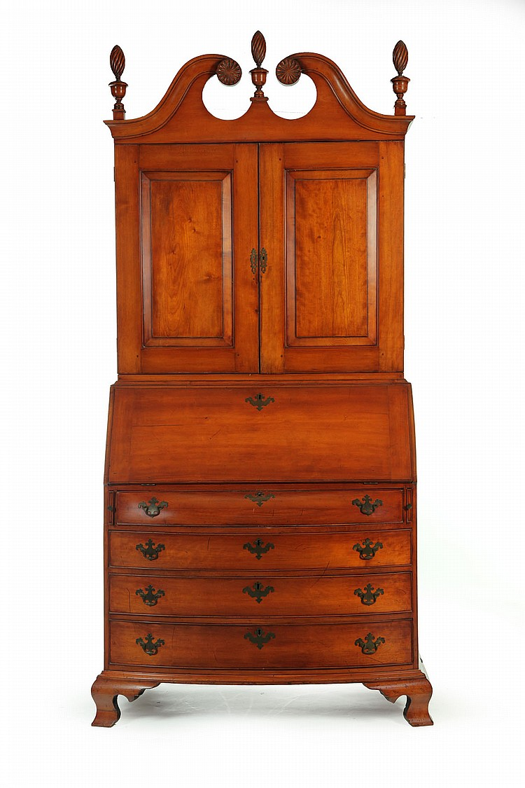 CHIPPENDALE BOWFRONT DESK-AND-BOOKCASE.