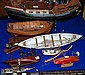A model of a junk and nine various model boats