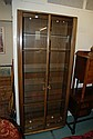 An Ercol glazed two door display cabinet