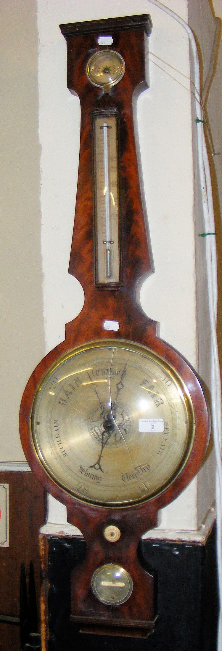 A mahogany cased banjo shaped mercurial