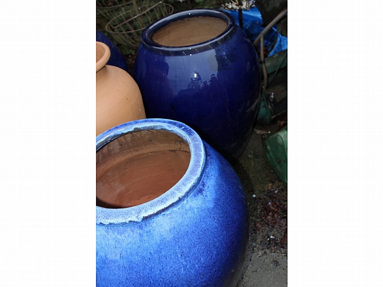 FOUR LARGE BLUE GLAZED GARDEN POTS