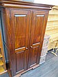 A modern hardwood dark stained wardrobe