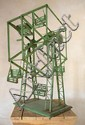 A GREEN PAINTED GALVANISED FERRIS WHEEL