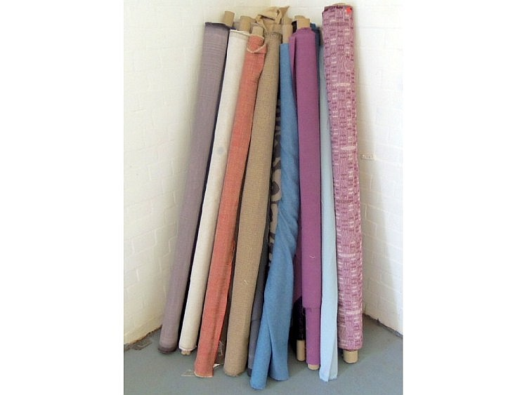 Various rolls of fabric