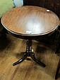 A MAHOGANY CIRCULAR OCCASIONAL TABLE on tripod