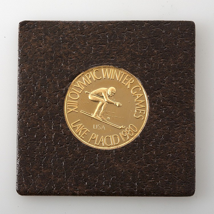 22K GOLD 1980 LAKE PLACID OLYMPIC WINTER GAMES COIN IN PRESENTATION BOX, WEIGHT .5 TROY OZ.