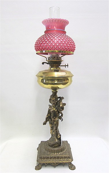 A VICTORIAN STYLE BRITISH BANQUET LAMP. The winged