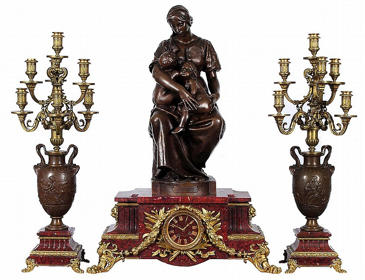 OUTSTANDING THREE PIECE PATINATED AND GILT BRONZE CLOCK GARNITURE