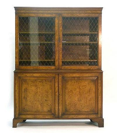 An 18th century-style walnut cabinet bookcase, the
