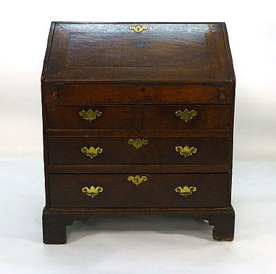 An early 18th century oak bureau with fall front