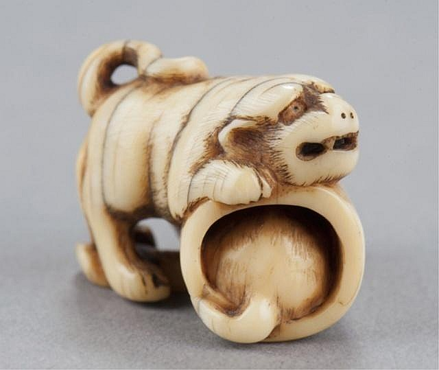 An ivory netsuke of tiger with cub.