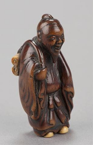 ,A wood netsuke of a Chinese scholar.