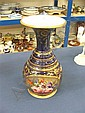 Late nineteenth century French porcelain vase with painted floral reserve on gilt and cobalt blue ground, 30cm