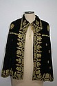 Black velvet cape with lavish gilt metal