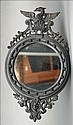 A 19th century cast iron wall mirror The circular
