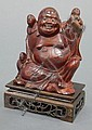 Hardwood Carving, China, seated figure of Budai with boys, wood stand, ht. 5 in.