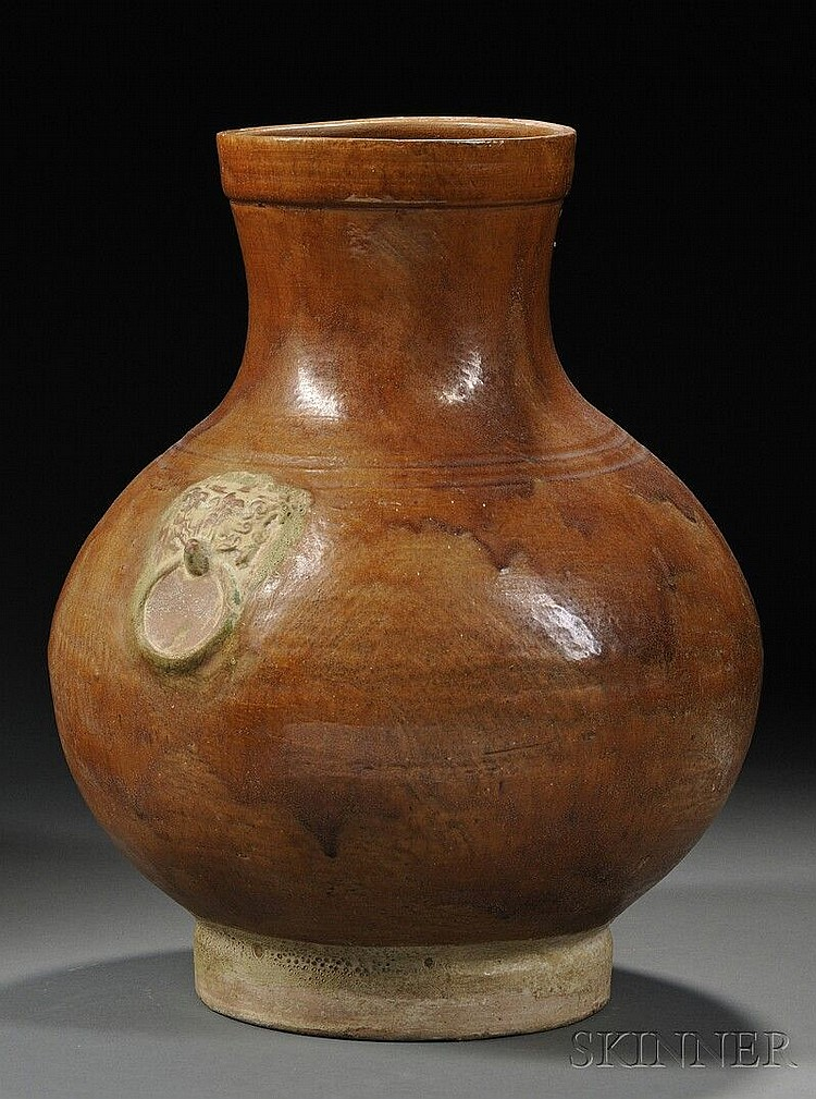 Glazed Wine Jar, China, Han dynasty (206 B.C.-220 A.D.), hu shape, covered in caramel-color glaze with green glazed taotie mask, rin...